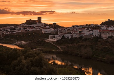 Sunset in Mertola, village of Portugal and its castle. Village in the south of Portugal in the region of Alentejo.