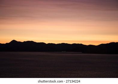 Sunset in the midwinter in Porsangerfjord