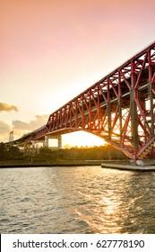 Sunset at the Minato Bridge (red bridge) in Osaka cross over Osaka sea port
