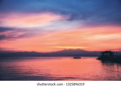 Sunset Mindanao, Philippines, With Mount Apo and Banca outrigger boat.