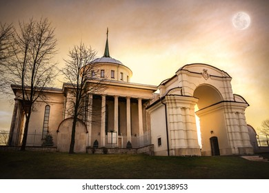 sunset and moon on the background of the church - Shutterstock ID 2019138953