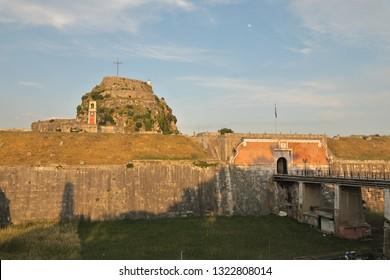 Sunset and moonlight on the Old Fortress of Corfu, Kerkyra, Corfu Island, Greece, Europe The Old Fortress of Corfu is a Venetian fortress in the city of Corfu. The fortress covers a promontory