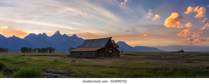 Sunset at Mormons Row overlooking the Moulton Barn and the Grand Teton Mountains in Wyoming.
