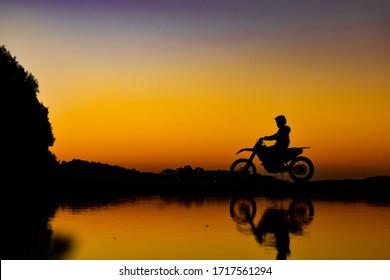 sunset motorbike ride across dam