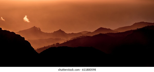 Sunset and mountain misty landscape panoramic view of Barranco de Tejeda and Barranco de la Culata, from La Ventana del nublo. One of the higest places in Gran Canaria Island.