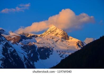 Sunset mountain peak clouds orange color, Mallnitz, Austrian Alps