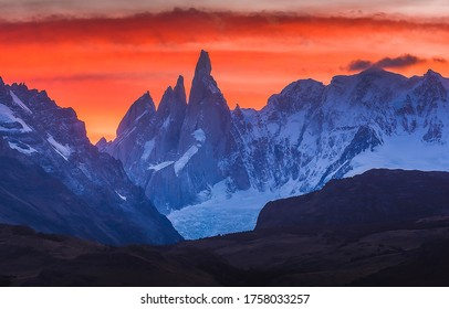 Sunset mountain peaks snow landscape. Mountain peak snow sunset view. Sunset mountain peak snow panorama - Shutterstock ID 1758033257