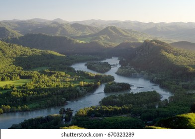 Sunset mountain river stream valley among green hills  Altai mountains, Siberia, Russia