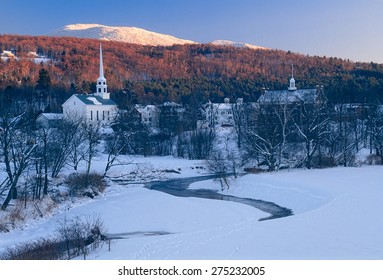 Sunset in the mountains behind the community church in the village of Stowe Vermont, USA.