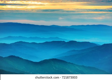 Sunset in the mountains. Dramatic colorful sky with blue hills