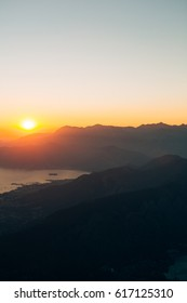 Sunset in the mountains. Sunset in the Montenegrin mountains. Sun to sit down behind the mountains.