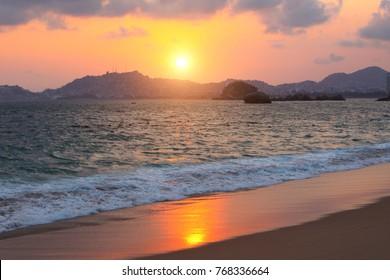 Sunset, mountains, ocean waves and beach, Acapulco de Juarez, Mexico, Pacific Ocean, North America