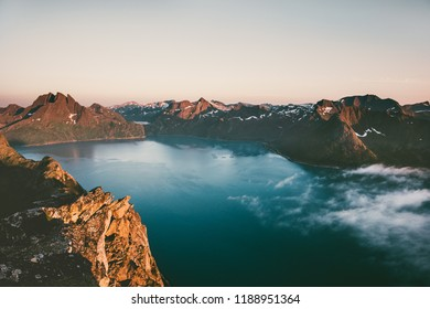 Sunset mountains over sea landscape in Norway aerial view Travel vacations breathtaking scenery Senja islands