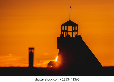 Sunset at Nallikari, Oulu with lighthouse silhouette.