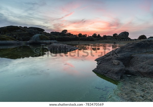 Sunset in the natural area of the Barruecos. Spain.