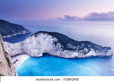 Sunset at Navagio beach with shipwreck view, Zakynthos Zante island, Greece. Zante is famous and very popular island to travel and summer resort in Greece.