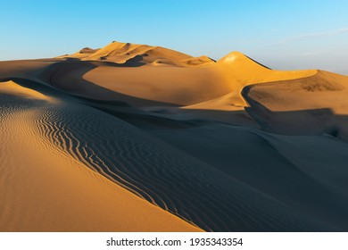 Sunset in the Nazca desert between Ica and Huacachina with sand ripples and dunes, Peru.