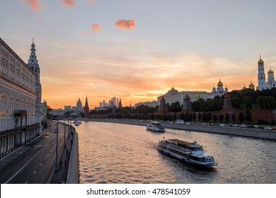 Sunset near famous historical landmark of Russia. The Moscow river, Red Square and Kremlin - Russia sights. Moscow landmark. Travel Russia and explore Moscow. Outdoor Russia landscape at dusk