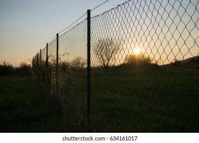 Sunset near fence. Slovakia