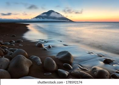 Sunset near the volcano Atsonupuri. Kuril Islands.