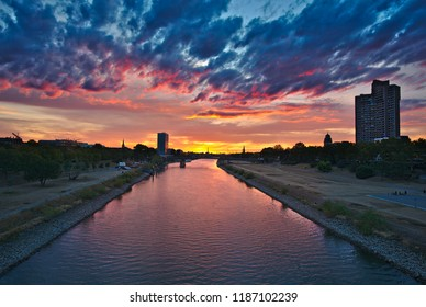 Sunset at the Neckar in Mannheim with red clouds