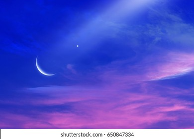 Sunset and new moon . Paradise heaven . Sunset and new moon . Mubarak background  .  Against the background of clouds . beautiful sky . Nasa  . Sunset and new moon  .  peaceful sky for the Muslim