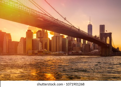 Sunset in New York City with a view of the Brooklyn Bridge and Lower Manhattan