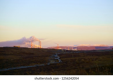 sunset in Norilsk factory smoking pipes
