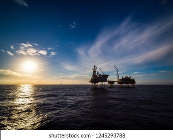 Sunset in North sea with a oil platform.