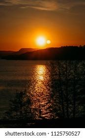 Sunset at norwegian fjord in spring