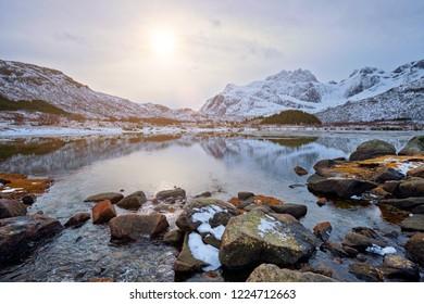 Sunset in Norwegian fjord in winter. Lofoten islands, Norway