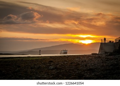 Sunset in Oban, Scotland, with ferryboat coming home