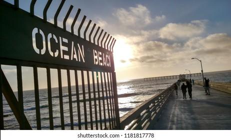 Sunset at Ocean Beach Pier on the Pacific Ocean.