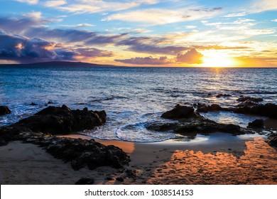 Sunset off the coast of Maui, Hawaii