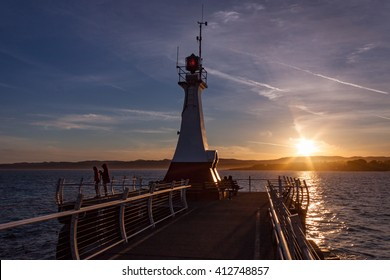 Sunset at the Ogden Point breakwater in Victoria, British Columbia