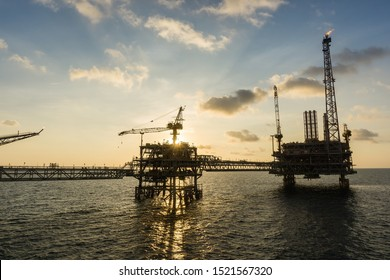 Sunset at oil production platform