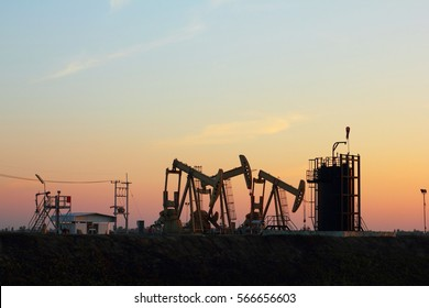 Sunset oil pump in the field