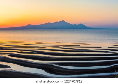 Sunset of Okoshiki coast in Kumamoto prefecture of Japan.On the day when low tide and sunset time coincide, a wonderful natural art appears.