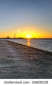 Sunset in the old docks of the Tejo river.