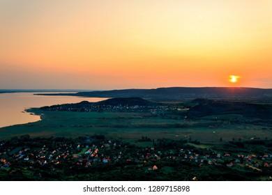 Sunset on the Balaton lake in Hungary top for the Badacsony hill.