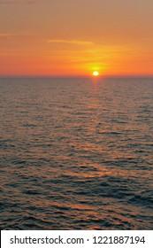 sunset on the Baltic sea, beautiful sunrise and waves on the sea