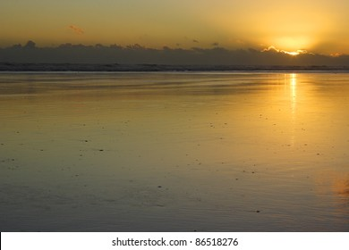 Sunset on Bayly's beach on the North island of New Zealand,