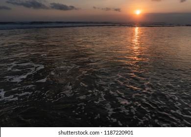 Sunset on the beach in canggu Bali
