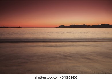 Sunset on a beach in Cannes city, soft focus