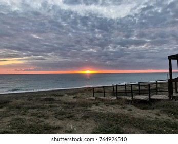 sunset on the beach with cloud and steps