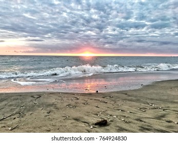 Sunset on the beach with clouds