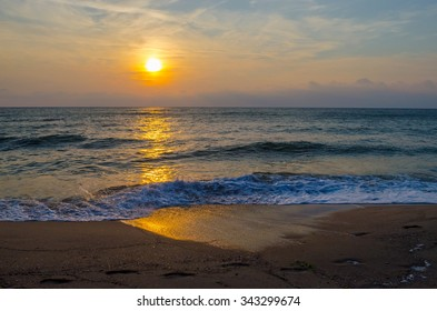Sunset on the beach. Colorful dawn over the sea. Dramatic sky