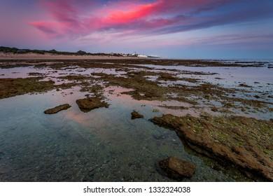 Sunset on the beach of the Corrales, fish pens, of Rota, Cadiz, Spain