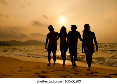 Sunset on the beach with friends