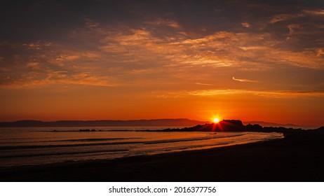 Sunset on the beach at greek village Arkoudi